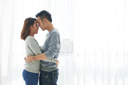 Photo for Young Vietnamese couple in love hugging - Royalty Free Image