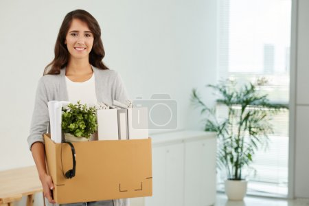 woman with box in new office