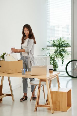 woman unpacking in new office