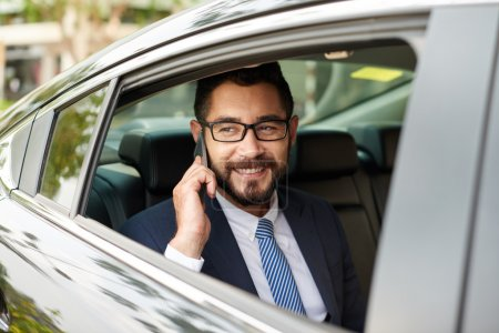 man in car talking on phone