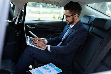 Man preparing for presentation in car