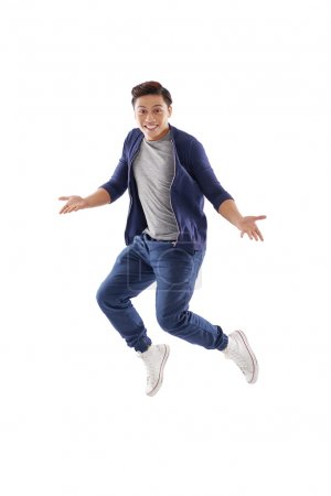 Surprised young man jumping