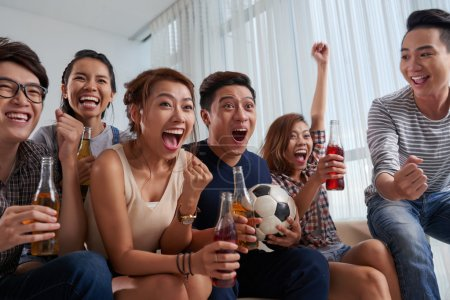 people watching soccer game at home