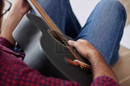 Musician enjoying playing his guitar