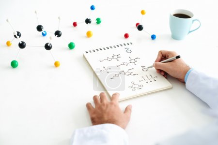 Photo for Close-up of chemist hand drawing chemical structure - Royalty Free Image