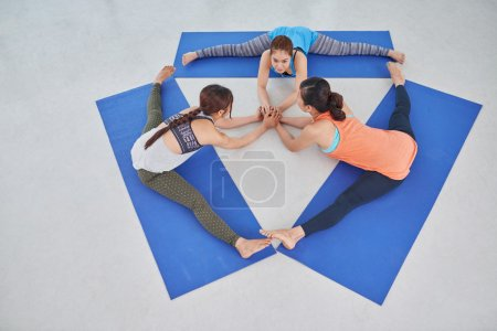 Sportswomen sitting in circle
