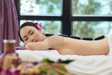 woman having spa stone therapy