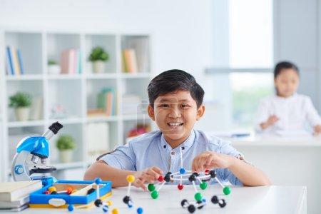 schoolboy sitting in chemistry class