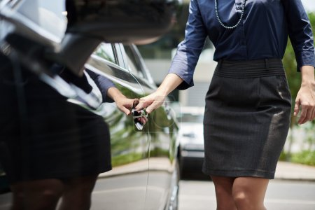 business lady opening door of her car