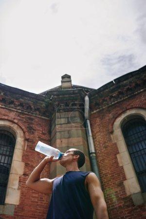 Thirsty sportsman drinking water
