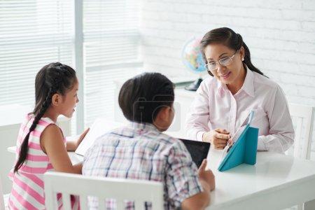 Teacher explaining something on tablet