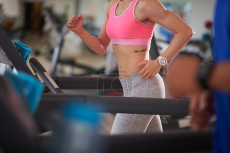 woman jogging in gym