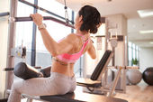 Woman working out with band assisted pull-up