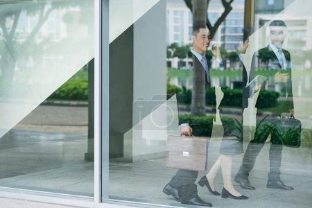 Entrepreneurs walking inside office building