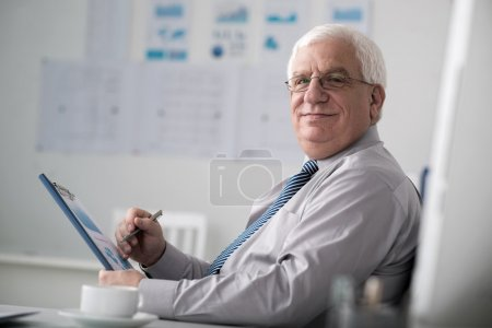 Mature entrepreneur working with papers