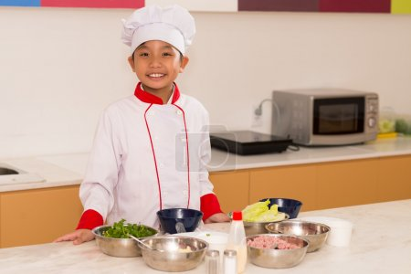 Happy little cook in the kitchen
