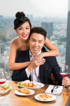 Vietnamese couple in a luxurious restaurant
