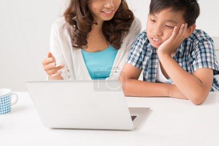 Doing homework at the laptop