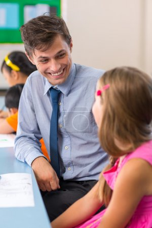 Young teacher talking to his pupil
