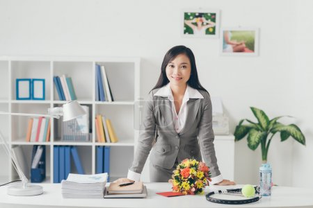 Asian business lady at her work place