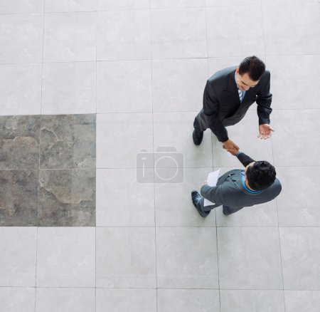 Photo for Businessmen shaking hands, view from the top - Royalty Free Image