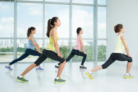 Young girls doing lunges