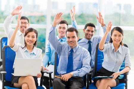 Business people raising hands