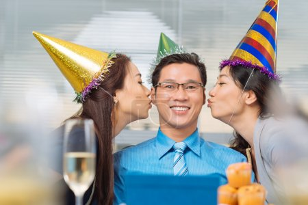 Birthday man kissed by colleagues