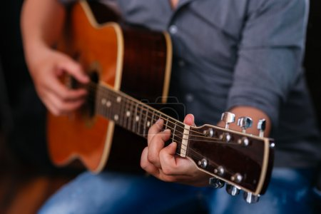 Photo for Male hands playing acoustic guitar, selective focus - Royalty Free Image