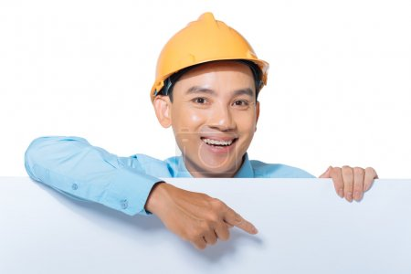 Vietnamese engineer pointing at the board