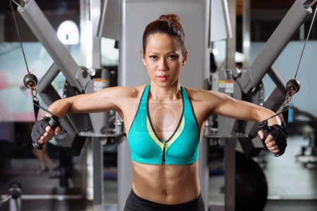 Photo for Professional sportswoman lifting weights in the gym - Royalty Free Image