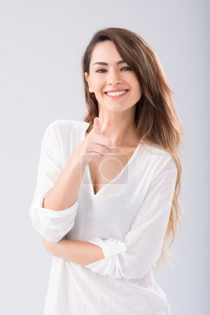 Photo for Portrait of happy young woman pointing at you - Royalty Free Image