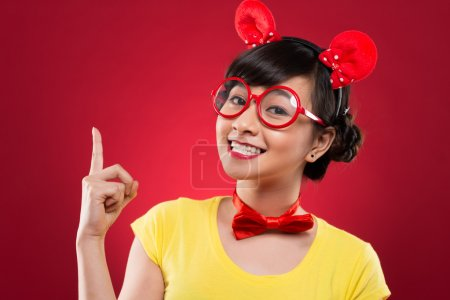 Photo for Portrait of cheerful girl in plastic glasses wearing mouse ears - Royalty Free Image