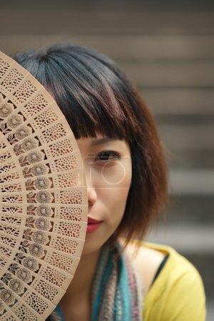 Vietnamese woman with a fan
