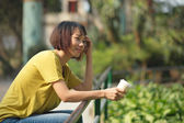 Woman drinking coffee in the park
