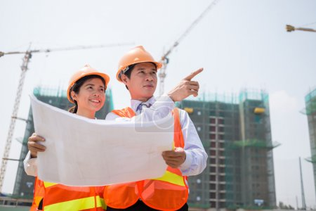 Supervisors inspecting construction site