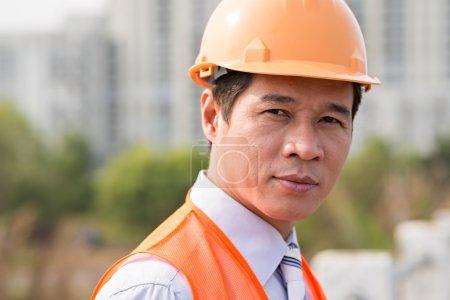 Foreman wearing orange hardhat