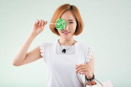 Korean girl with a lollipop