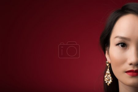 Photo for Half-faced portrait of Chinese woman looking at the camera - Royalty Free Image