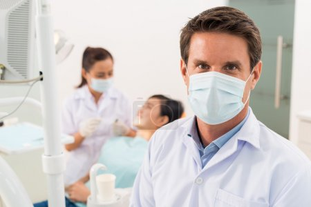 Dentist wearing protective mask