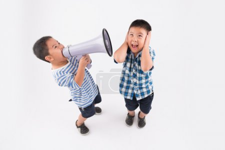 boy screaming in megaphone