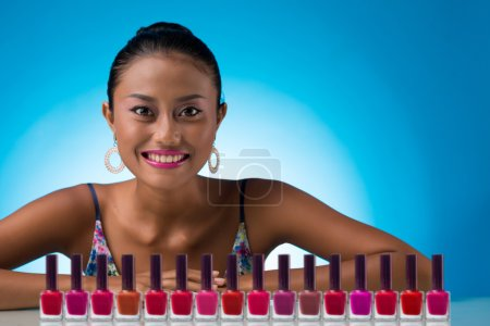 Woman with colorful nail polishes