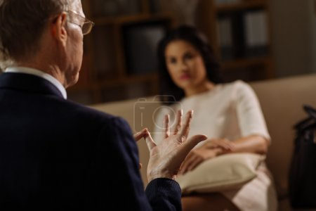 Psychologist using fingers in conversation