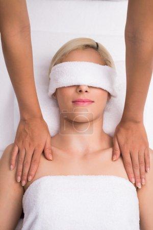 Young woman having spa procedure