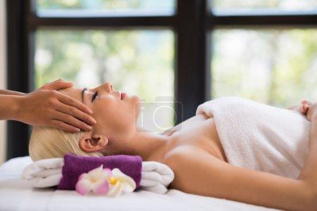 Woman getting Professional head massage