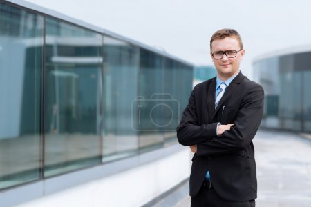 Photo for Portrait of confident young businessman standing outdoors - Royalty Free Image