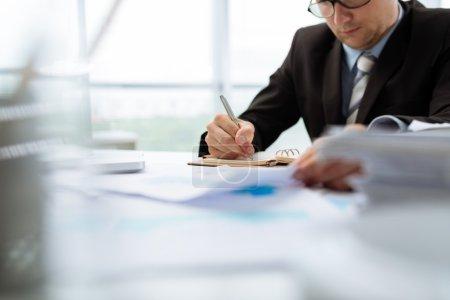 Businessman making notes