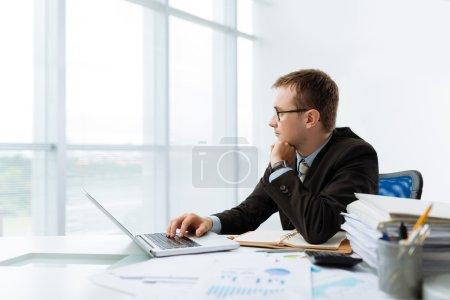 ntrepreneur working on laptop