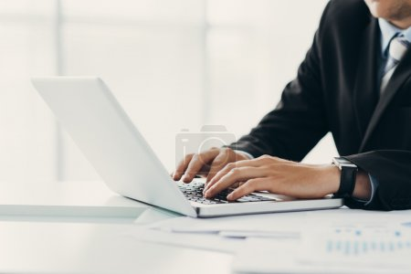Photo for Hands of business person typing on laptop, selective focus - Royalty Free Image