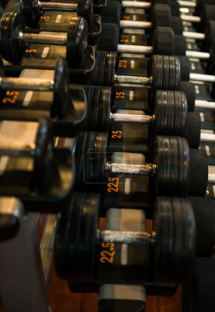 Photo for Row of different black dumbbells in sports club - Royalty Free Image